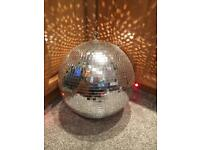 Large rotating disco ball party