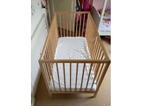 £15 Like new wooden cot and mattress from IKEA