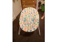 Immaculate baby bouncy chair, used once, has safety tags still attached.