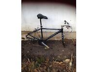 Bike frames (Bianchi & Pinnacle) and 3 wheels