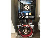 Brand new dart board, cabinet, laser oche, darts and a few extra accessories