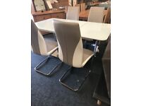 Modern extendable table and four new leather chairs