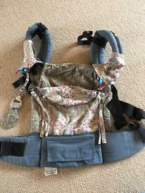 Tula baby carrier with all custom accessories