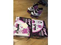 2 pairs of Osprey Adjustable Skates, sizes 13 - 3
