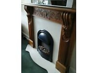 ornate hand carved reclaimed pine fire surround, shaped marble hearth and back, electric fire.