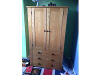 Solid Oak Wardrobe, from New Heights, a rail one side, deep shelves the other. Suit boys room.