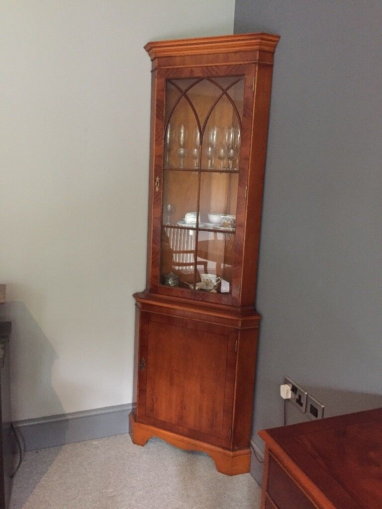 Yew display cabinet in excellent condition and interior light