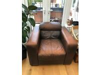 Single brown leather armchair