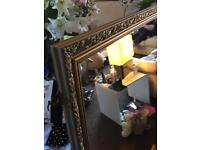 Large gilded mirror 35 years old.