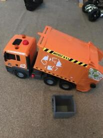 Large hydraulic garbage truck and bin.