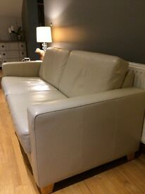 2 cream leather sofas ( can be sold separately or as a pair )