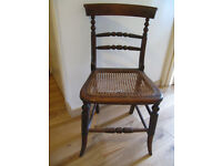 antique bedroom chair (mahogany?) with graceful turned work on back, legs, stretchers; seat damaged.