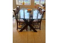 Beautiful dining table and 4 vintage leather chairs