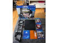 Sony PlayStation 4 slimline 500gb with 5 games