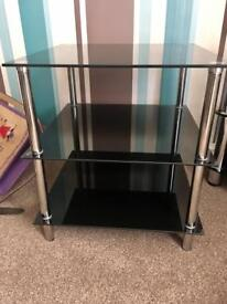Matching glass tv stand and table