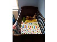 Rarely used OBaby Grace walnut cotbed for kids suitablebfor 0- 6 year old kids along with mattress.