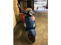 Vespa lx125 in blue with 1 year mot