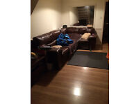Dark brown corner sofa with sofabed and Recliner. It's in perfect condtion. Very well looked after.