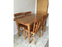 Country style pine dining table and four chairs 121cm X 75cm £100 Ono