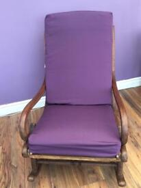 A rustic Parker Knoll rocking chair