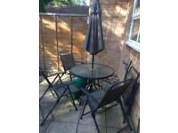 Glass table and 4 garden chairs
