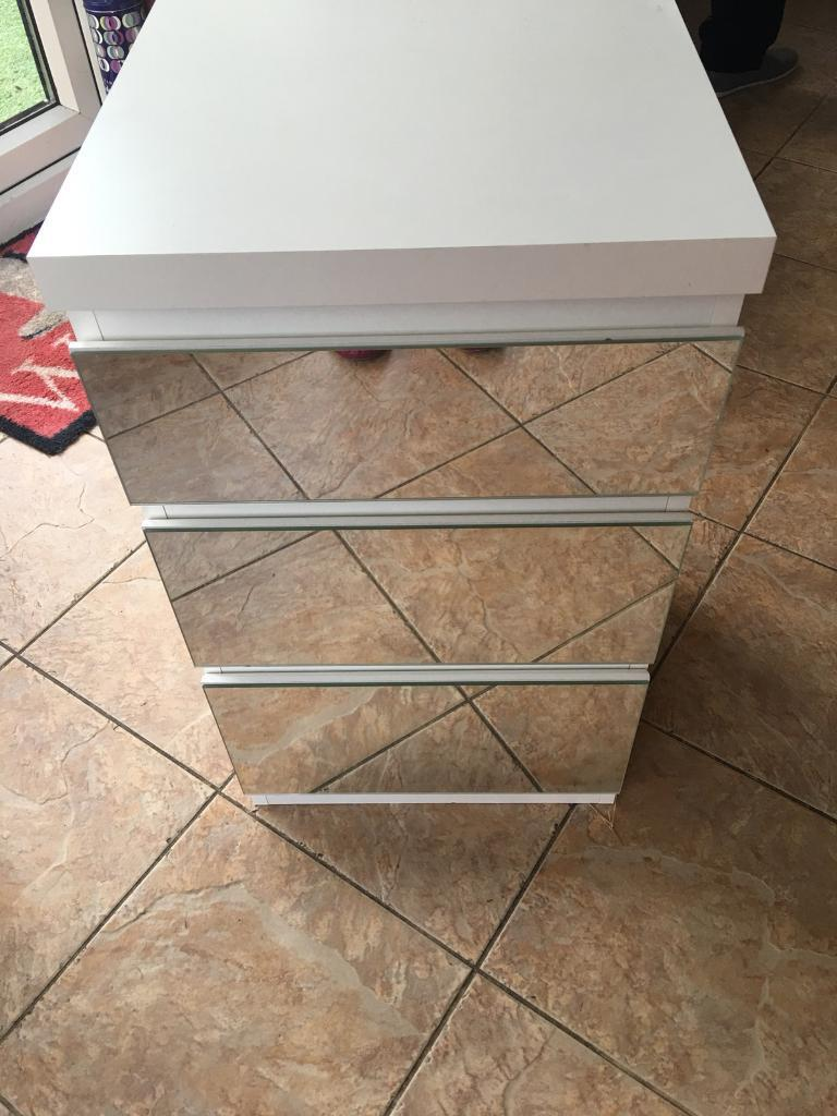White mirrored bedside tables and dressing table