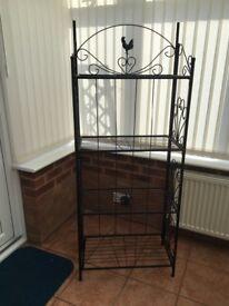 Black cast iron unit with four shelves