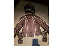 Motorbike jacket. Helmet and gloves