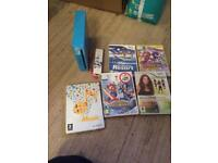 Blue Nintendo Wii console and games