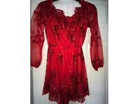 Red playsuit for sale size 10
