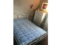 white metal double bed frame and matress