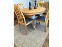 Round extending dining table & 4 dining chairs