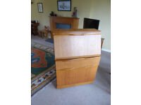 Small Veneered 29 inch wide Bureau on castors and in good condition.