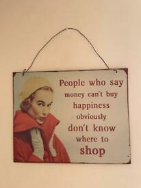 Retro vintage wall sign 'People Who Say Money Can't Buy Happiness Don't Know Where To Shop!''