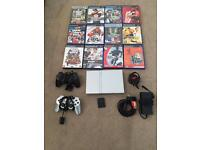 Sony PlayStation 2 Slim in silver 12 games, 2 controllers and memory card