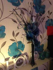 teal flower with vase