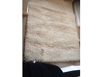 Shag pile rug in oatmeal 1.20m X 1.70m. Excellent condition and clean.