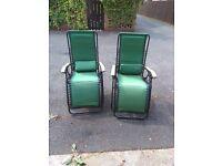 A pair of tillington green reclining chairs.