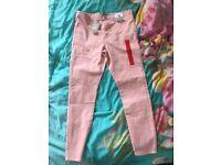 Light pink skinny jeans