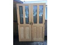 Pair of 4 panel oak glazed internal doors