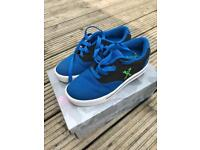 Blue wheeled trainers size 4