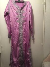 Moroccan abaya dress with trousers.