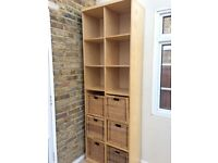 Tall storage unit with baskets