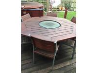 Garden table with hot plate