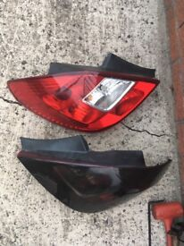 Corsa d tail gate light Both as a pair ones tinted and one isn't
