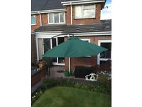 3 metre banana parasol. Wind out and wind close. Never used
