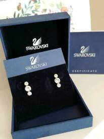 Swarovski three crystal earrings gold plated in original box with authentication certificate