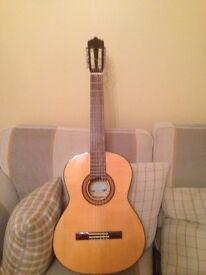 Left handed Santos Martinez classical guitar.