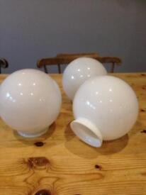 3 white glass lamp shades.