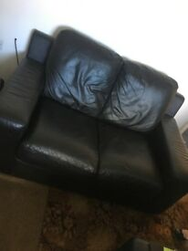 Two and three seater black leather couch